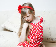 Portrait of a thoughtful little girl Royalty Free Stock Photos