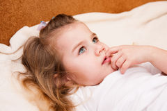 Portrait of thoughtful little girl. Stock Images