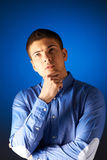 Portrait of thoughtful man against blue Royalty Free Stock Photography