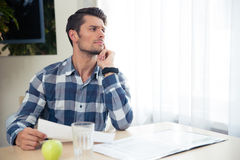 Portrait of a thoughtful man checking bills Royalty Free Stock Photo