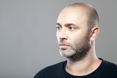 Portrait of thoughtful mature caucasian man isolated on gray Royalty Free Stock Photography