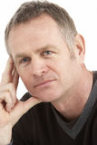 Portrait Of Thoughtful Middle Aged Man Royalty Free Stock Photography