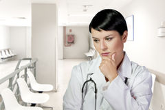 Portrait of a thoughtful middle aged nurse Stock Images