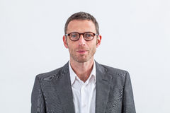 Portrait of thoughtful modern male manager with eyeglasses Stock Photos