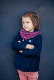 Portrait of thoughtful preschooler girl outdoor. Young toddler girl outdoor. This image has attached release Stock Photos