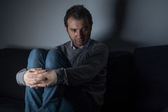 Portrait of thoughtful sad man alone Stock Photography