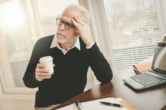 Portrait of thoughtful senior businessman stock photography
