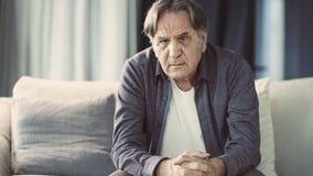 Portrait of thoughtful senior man stock image