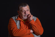 Portrait of a thoughtful senior man Stock Photos