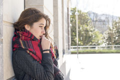 Portrait thoughtful and serious woman in the street. Stock Photography