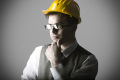 Portrait of thoughtful smart young engineer Stock Image