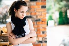Portrait of thoughtful teen girl on terrace Stock Photos