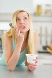 Portrait of thoughtful teenager girl with yogurt Stock Photography