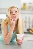 Portrait of thoughtful teenager girl with yogurt Stock Photography