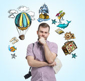 A portrait of thoughtful tourist who is surrounded by summer vacation icons which are drawn on the light blue background. Stock Photography