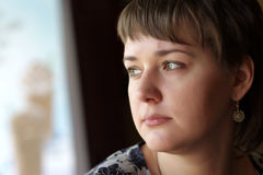 Portrait of thoughtful  woman Stock Photography