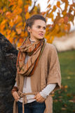 Portrait of thoughtful woman in beautiful evening autumn park Royalty Free Stock Photo