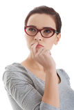 Portrait of thoughtful woman in eyeglasses. Stock Photo