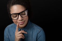 Portrait of a thoughtful woman. In front of black background Royalty Free Stock Photo