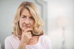 Portrait of thoughtful woman at home. Portrait of thoughtful senior woman at home Stock Images