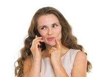Portrait of thoughtful woman talking mobile phone Royalty Free Stock Photo