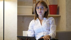 Portrait of thoughtful woman with touchpad, businesswoman at home stock video footage