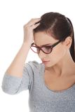 Portrait of thoughtful woman wearing glasses Stock Photography
