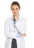 Portrait of thoughtful woman in white robe Stock Photography