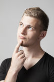 Portrait of thoughtful young caucasian man isolated on gray Royalty Free Stock Photography