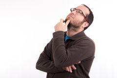 Portrait of thoughtful young man looking up isolated Royalty Free Stock Image