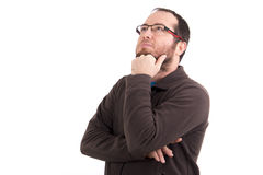 Portrait of thoughtful young man looking up isolated Stock Photography