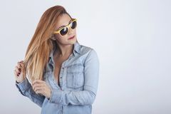 Portrait of thoughtful young woman with sunglasses stock images