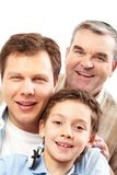 Portrait of three. A vertical shot of three male members of the family belonging to different generations Royalty Free Stock Image