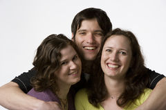 Portrait of three adult siblings. Portrait of two sisters with their brother on a white background Stock Photo