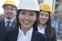 Portrait of three architects wearing hardhats, Beijing Stock Photos