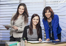 Portrait of a three attractive female colleagues Royalty Free Stock Photo