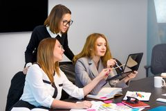 Three business women working in office Royalty Free Stock Photography