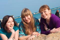 Portrait of three attractive girls Stock Photos