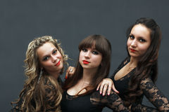 Portrait of three attractive sexy dancers Stock Photos
