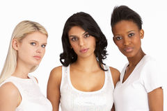 Portrait Of Three Attractive Young Women In Studio. At Camera stock photography
