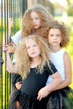 Portrait of a three  beautiful fashion little girls Royalty Free Stock Photography
