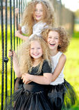 Portrait of a three  beautiful fashion little girls Royalty Free Stock Photos