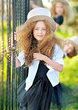 Portrait of a three  beautiful fashion little girls Stock Photos