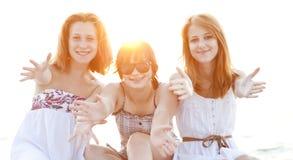 Portrait of three beautiful girls at the beach. Stock Photos