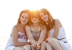 Portrait of three beautiful girls at the beach. Royalty Free Stock Image