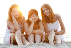 Portrait of three beautiful girls at the beach. Stock Photo