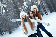 Portrait of three beautiful girls in winter park Stock Images