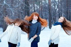 Portrait of three beautiful girls in winter park Royalty Free Stock Photography
