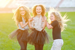 Portrait of a three beautiful little girls Stock Photo