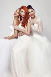 Portrait of a three beautiful woman in wedding dress Royalty Free Stock Image